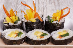 Asian delicacy. Close up image of Korean sushi displayed on a plate Stock Images