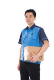Asian delivery male. In white background Royalty Free Stock Photography
