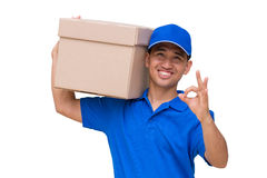 Asian delivery man carrying a parcel box and giving OK sign Stock Photo