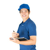 Asian delivery man. Writing on notepad stock photography