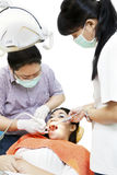 Asian dentist with assistant and patient Stock Photos