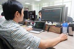 Asian Developer Using Laptop Computer Sitting stock photography