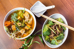 Asian dinner dishes - soup and salad Stock Image
