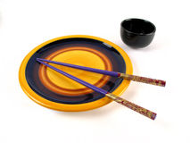 Asian dinner set. Typical asian dinner set (plate, sticks and tea cup Stock Photos