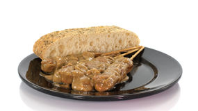 Asian dish with bread and sate Royalty Free Stock Photography