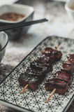 Asian Dish: Caramelised Pork with soy sauce and honey Stock Photos