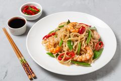 Asian dish of fried rice noodles with shrimp and vegetables royalty free stock photo