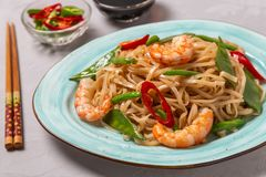Asian dish of fried rice noodles with shrimp and vegetables royalty free stock photos