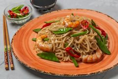 Asian dish of fried rice noodles with shrimp and vegetables royalty free stock photography