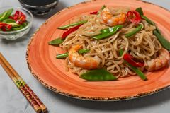 Asian dish of fried rice noodles with shrimp and vegetables stock photo