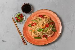 Asian dish of fried rice noodles with shrimp and vegetables stock photos