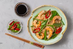Asian dish of fried rice noodles with shrimp and vegetables. The view from the top. Copy-space. royalty free stock photos