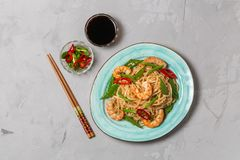 Asian dish of fried rice noodles with shrimp and vegetables. The view from the top. Copy-space. stock images