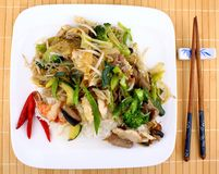 Asian dish with glass noodles, rice, meat, prawn and vegetables Royalty Free Stock Photos