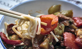 Asian dish. Lagman is a popular Central Asian national dish, prepared from meat, vegetables and drawn long noodles stock photos
