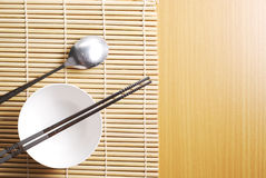 Asian dish place setting on bamboo mat, Korean style Royalty Free Stock Photos