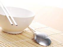 Asian dish place setting on bamboo mat. Korean style Royalty Free Stock Photos