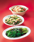 Asian dishes. Dishes of asian cuisine on red background Stock Image
