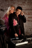 Asian DJ with blond woman Royalty Free Stock Photography