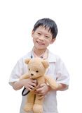 Asian doctor boy holding bear toy Stock Photography