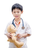 Asian doctor boy measuring temperature bear toy Stock Photos