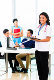Asian doctor check-up on patient Stock Photography