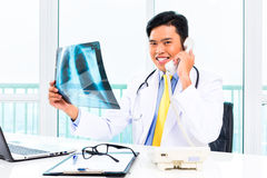 Asian doctor diagnosis radiograph in practise Stock Image