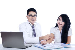 Asian doctor examines his patient isolated Royalty Free Stock Photos