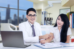 Asian doctor examines his patient Stock Photo