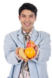 Asian doctor fruit Royalty Free Stock Image