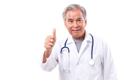 Asian doctor giving thumb up gesture stock images