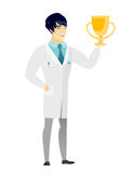 Asian doctor holding a golden trophy. Stock Images