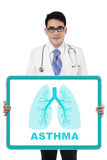 Asian doctor holding lungs symbol on the board Stock Photos