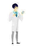 Asian doctor holding a mobile phone. Royalty Free Stock Photography