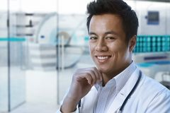 Asian doctor in hospital MRI room stock images