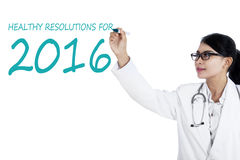 Asian doctor makes healthy resolutions Stock Images
