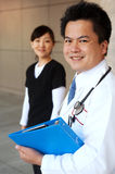 Asian doctor with nurse in background Royalty Free Stock Image