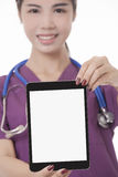 Asian doctor or nurse holding tablet computer isolated on a white background Royalty Free Stock Photo