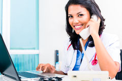 Asian doctor in office administration work Royalty Free Stock Images