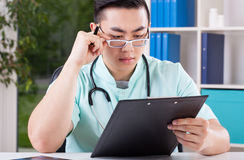Asian doctor in office Royalty Free Stock Photo