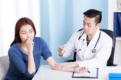 Asian doctor and patient during doing injection Stock Photography
