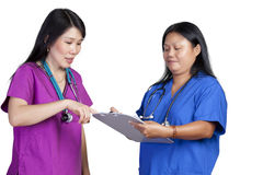 Asian Doctor's viewing chart Royalty Free Stock Photo