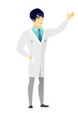 Asian doctor showing a direction. Royalty Free Stock Photos