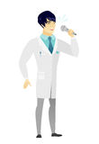 Asian doctor singing to the microphone. Royalty Free Stock Image