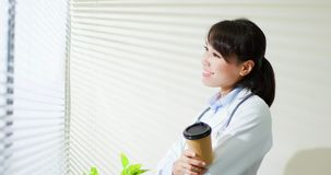 Asian doctor woman drink coffee royalty free stock photos