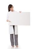 Asian doctor woman holding blank board. Full length portrait  on white background Stock Photography