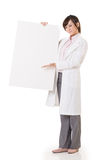 Asian doctor woman holding blank board. Full length portrait  on white background Stock Images