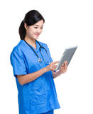 Asian doctor woman look at digital tablet Royalty Free Stock Photo
