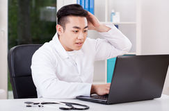 Asian doctor during work Stock Photography