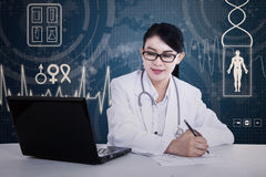 Asian doctor is writing prescription Royalty Free Stock Photo